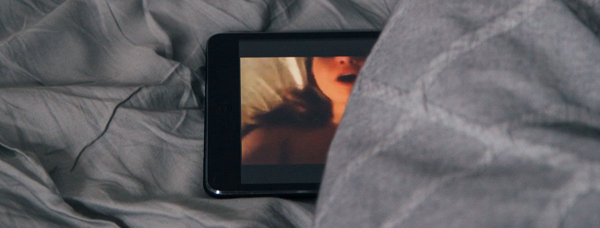 bed with ipad playing porn movie