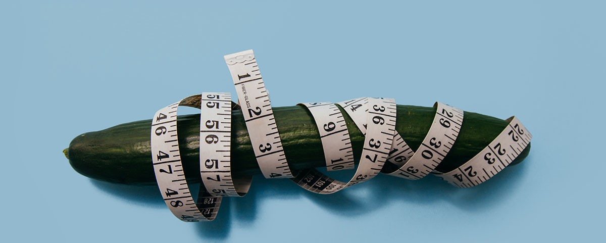 cucumber tied with measuring tape as penis