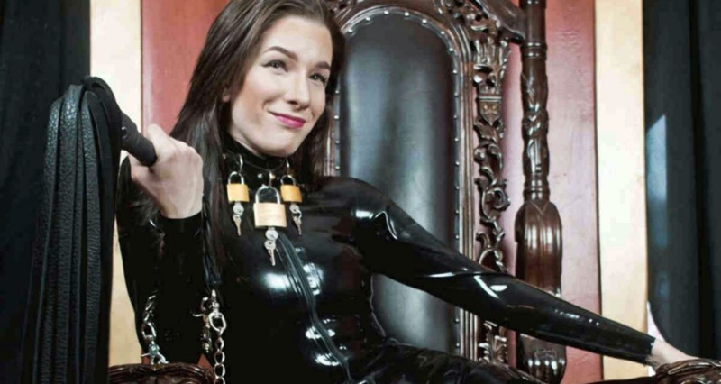 female dominatrix with a whip