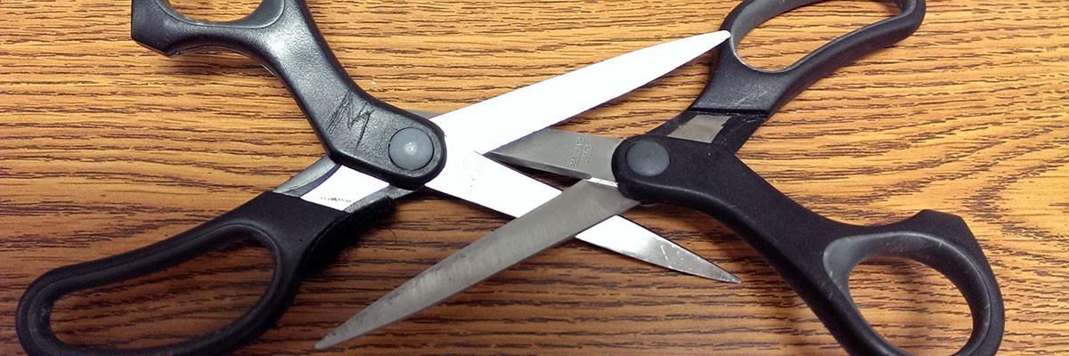 two pairs of scissors showing sex position